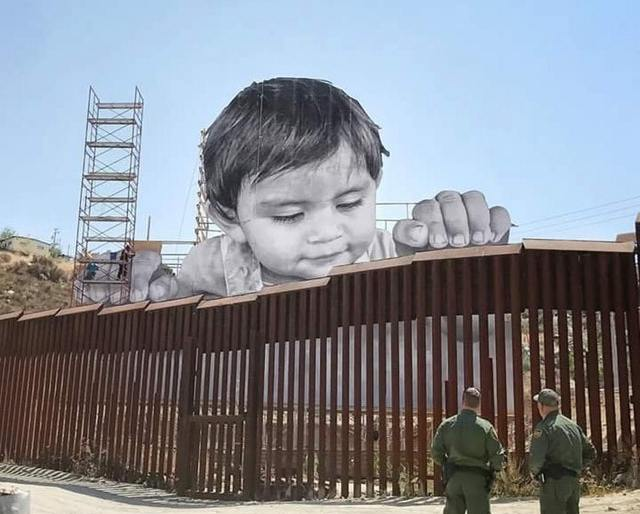 Kid on the Mexican side of the US/MEXICO border – StreetArt by JR